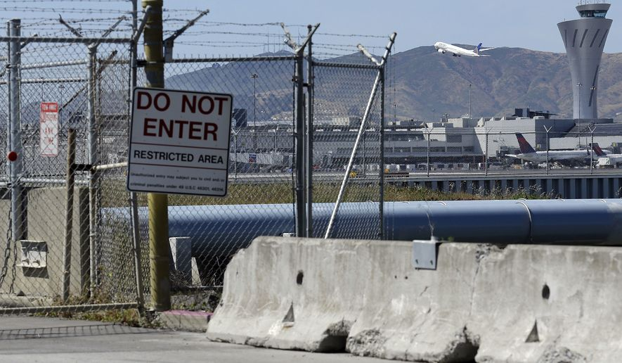 ADVANCE FOR THURSDAY, MAY 26, 2016, AND THEREAFTER - In this May 17, 2016, photo, a plane takes off from San Francisco International Airport from behind fencing at the Millbrae Gate, in San Francisco. An Associated Press investigation has documented perimeter breaches at many of the busiest airports in the U.S. (AP Photo/Jeff Chiu)