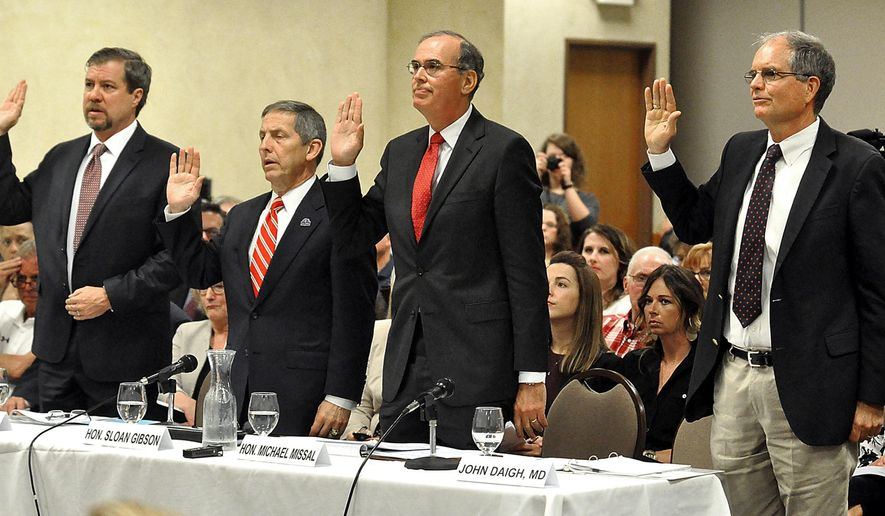 Witnesses from the Department of Veterans Affairs, from left, Gavin West, a senior medical adviser, Sloan Gibson, a deputy secretary, Michael Missal, an inspector general, and John Haigh, an assistant inspector general for health care inspections, are sworn in during a field hearing of the Senate Homeland Security and Governmental Affairs Committee in Tomah, Wis., Tuesday, May 31, 2016. (Steve Rundio/La Crosse Tribune via AP) MANDATORY CREDIT