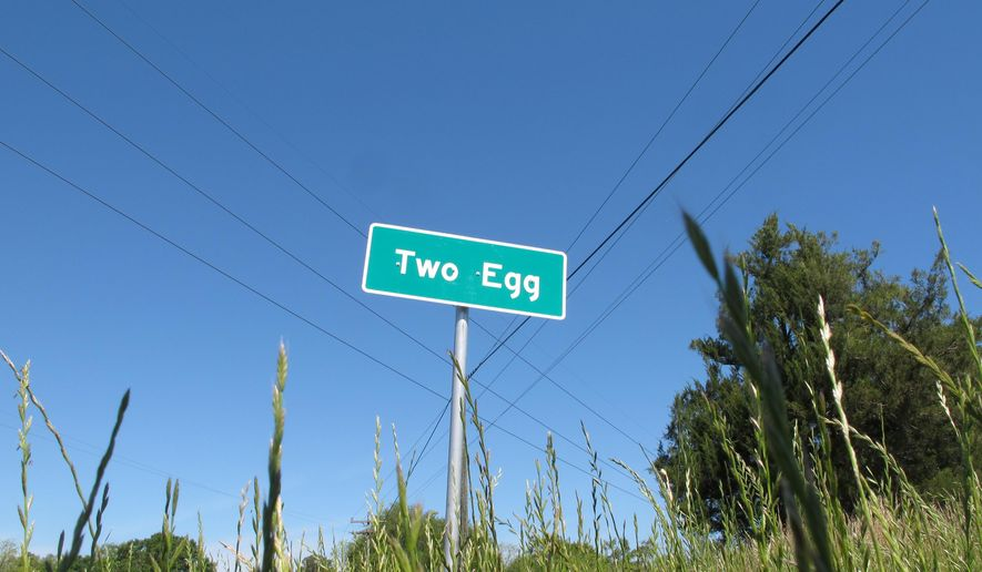In this April 18, 2016 photo, a sign welcomes motorists to the town of Two Egg, Fla. Located about 70 miles northwest of Tallahasee, Fla., Two Egg is a small farming community where people used to trade eggs for goods. (AP Photo/Brendan Farrington)