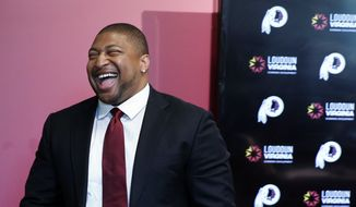 Former Washington Redskins defensive end Stephen Bowen smiles after speaking during a media availability at the team's NFL football training facility at Redskins Park, Wednesday, June 1, 2016 in Ashburn, Va. The Redskins announced Bowen had retired from the NFL earlier Wednesday, after 10 years in the league. (AP Photo/Alex Brandon)
