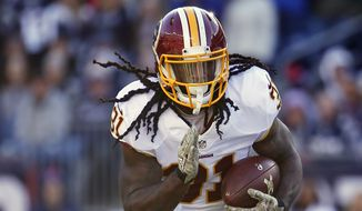 Washington Redskins running back Matt Jones runs the ball against the New England Patriots during a NFL football game at Gillette Stadium in Foxborough, Mass. Sunday Nov. 8, 2015. (Winslow Townson/AP Images for Panini)