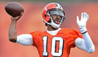 Cleveland Browns' Robert Griffin III throws a pass during practice at the NFL football team's veteran minicamp, Tuesday, April 19, 2016, in Berea, Ohio. (AP Photo/David Dermer)