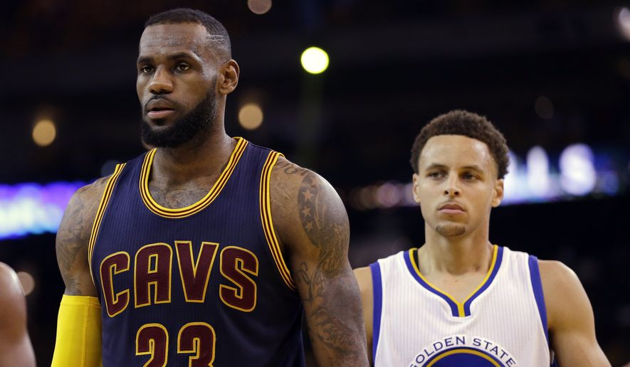 Cleveland Cavaliers forward LeBron James (23) walks in front of Golden State Warriors guard Stephen Curry (30) during the first half of Game 5 of basketball's NBA Finals in Oakland, Calif., Sunday, June 14, 2015. (AP Photo/Ben Margot)