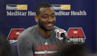 Washington Wizards guard John Wall reacts during a media availability before an NBA basketball game against the Atlanta Hawks, Wednesday, April 13, 2016, in Washington. (AP Photo/Nick Wass)