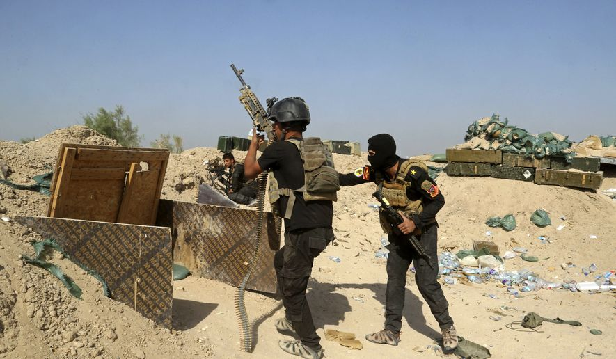 Iraqi counterterrorism forces face off with Islamic State militants in the Nuaimiya neighborhood of Fallujah, Iraq, Wednesday, June 1, 2016. The U.N. children's fund has issued a stark warning to Iraqi troops and Islamic State militants to spare the children amid a battle to retake the city of Fallujah city. (AP Photo/Khalid Mohammed)