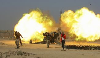 In this Sunday, May 29, 2016 photo, Iraqi security forces and allied Popular Mobilization forces fire artillery during fight against Islamic State militants in Fallujah, Iraq. Iraqi forces this week pushed into the city's southern sections after securing surrounding towns and villages more than 50,000 people are believed to be trapped inside the Sunni majority city, about 65 kilometers (40 miles) west of Baghdad. (AP Photo/Anmar Khalil)