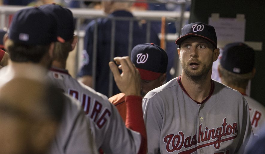 Washington Nationals' Max Scherzer, right, looks on from the dugout following the eighth inning of a baseball game against the Philadelphia Phillies, Wednesday, June 1, 2016, in Philadelphia. The Nationals won 7-2. (AP Photo/Chris Szagola)