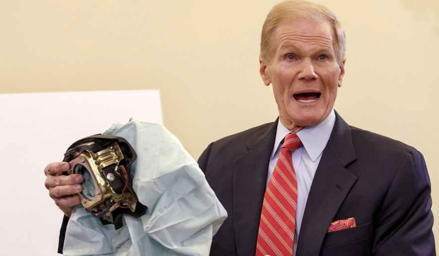 In this Nov. 20, 2014, file photo, Senate Commerce Committee member Sen. Bill Nelson, D-Fla., holds an example of a defective air bag made by Takata of Japan that has been linked to multiple deaths and injuries in cars driven in the U.S., during a hearing on Capitol Hill in Washington. (AP Photo/J. Scott Applewhite, File)