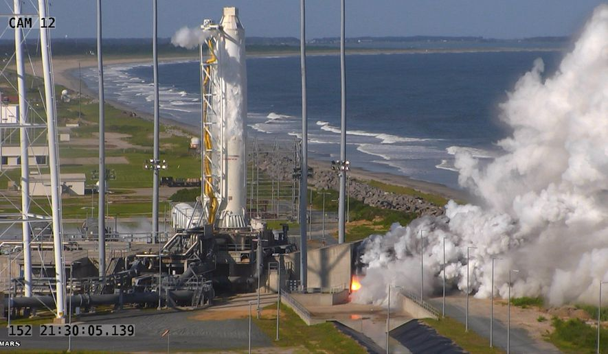 This image provided by NASA shows an Orbital ATK full-power test of the upgraded Antares medium-class rocket using new RD-181 engines at the at Virginia Space's Mid-Atlantic Regional Spaceport at NASA Wallops Island Test Flight Facility in Wallops Island, Va., Tuesday May 31, 2016. Orbital ATK hopes to resume cargo resupply services to the International Space Station from NASA's Wallops Flight Facility in Virginia, currently scheduled for July. (NASA via AP)
