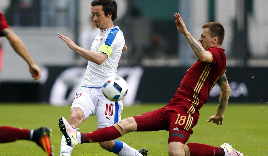 Tomas Rosicky of Czech Republic, left, and Russia's Oleg Ivanov challenge for the ball during a friendly soccer match between Czech Republic and Russia in Innsbruck, Germany, Wednesday, June 1, 2016. (AP Photo/Matthias Schrader)