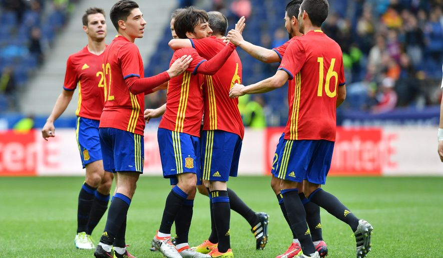 Spain's  players celebrate after scoring during a friendly soccer match between Spain and South Korea in Salzburg, Austria, Wednesday, June 1, 2016. The Spain National Football Team is in Austria for a training camp in preparation for the  EURO 2016 soccer championships, hosted by France.(AP Photo/Kerstin Joensson)