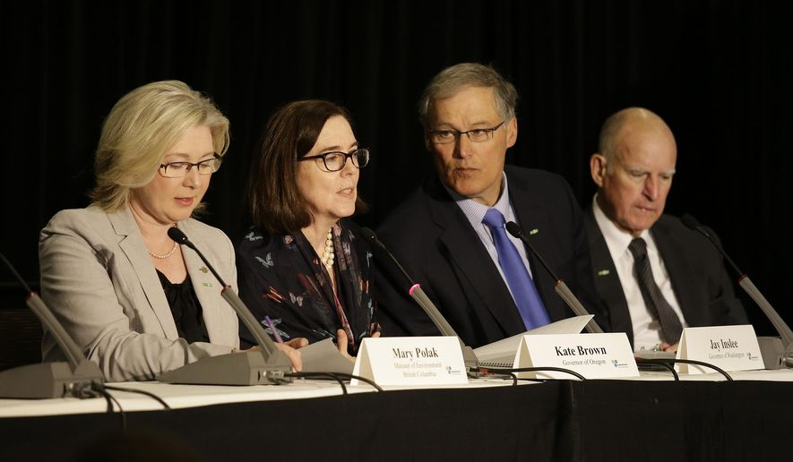 From left, Mary Polak, Minister of Environment of British Columbia, Canada, Oregon Gov. Kate Brown, Washington Gov. Jay Inslee and California Gov. Jerry Brown take part in a roundtable discussion during the Subnational Clean Energy Ministerial Wednesday, June 1, 2016, in San Francisco. (AP Photo/Eric Risberg)