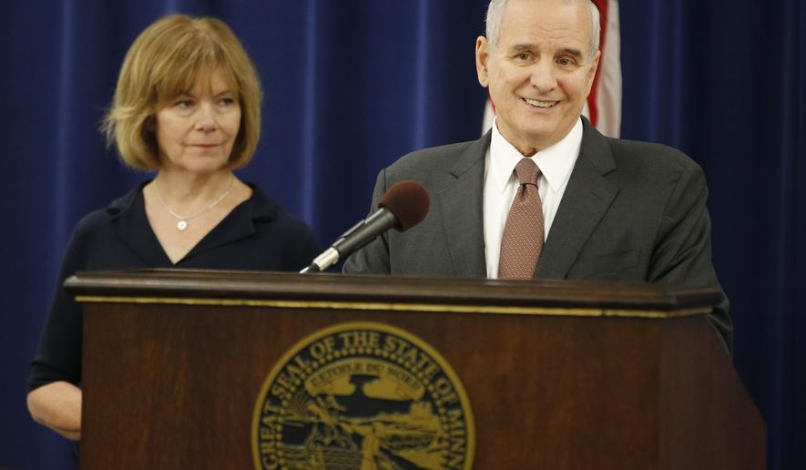 Gov. Mark Dayton addresses the need for a special one-day session at the State Capitol in St. Paul, Minn., Wednesday, June 1, 2016. Lt. Gov. Tina Smith answered some questions as well. (Richard Tsong-Taatarii /Star Tribune via AP)  MANDATORY CREDIT; ST. PAUL PIONEER PRESS OUT; MAGS OUT; TWIN CITIES LOCAL TELEVISION OUT