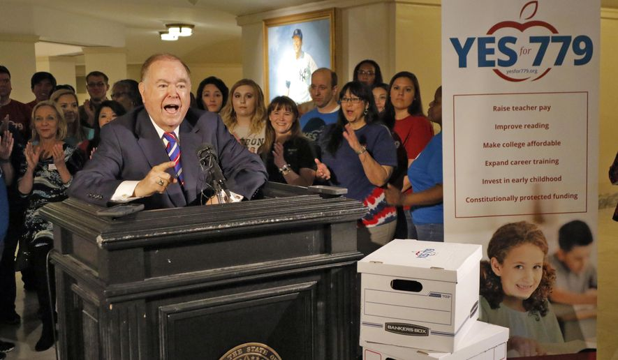 FILE - In this Thursday, April 21, 2016 file photo, University of Oklahoma President David Boren speaks as he joined education advocates to deliver more than 300,000 signatures to launch the Yes for 779 campaign, to the Oklahoma Secretary of State's office at the State Capitol in Oklahoma City. The Oklahoma Supreme Court is giving the green light to a state question in November for a penny sales tax hike to pay for teacher pay raises and other education projects. (Steve Gooch/The Oklahoman via AP, File)