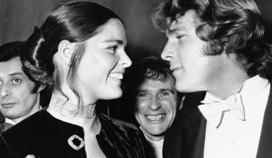 "FILE - In this March 8, 1971 file photo, co-stars Ali MacGraw, left, and Ryan O'Neal appear at the Odeon Theatre, Leicester Square in London to attend Royal Film showing of their film,  ""Love Story."" (AP Photo, File)"