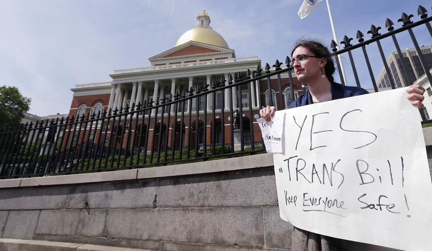Asa Goodwillie, of Watertown, Mass., who is transgender, protests outside the Statehouse in Boston, Wednesday, June 1, 2016. The Massachusetts House is debating a transgender rights bill that Democratic leaders expect to be passed, and Republican Gov. Baker has promised to sign if it reaches his desk. The bill would expand existing protections for transgender people to public accommodations and allow them to use the restroom or locker room that matches their gender identity. (AP Photo/Charles Krupa)