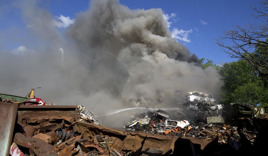 Firefighters respond following an explosion in a scrap pile at All Metals Recycling in Madison, Wis., Wednesday, June 1, 2016. The recycling plant is about 2 miles south of the state Capitol. (Steve Apps/Wisconsin State Journal via AP) MANDATORY CREDIT