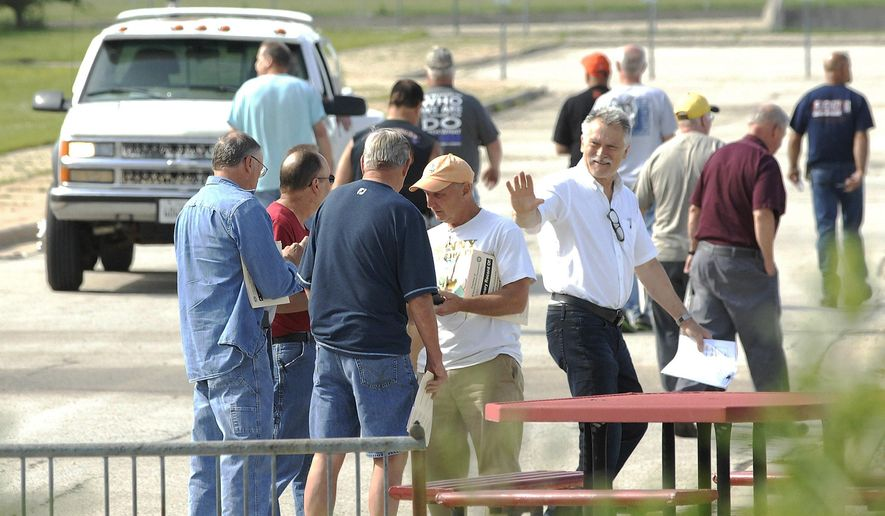 About 175 Mitsubishi employees say their goodbyes to friends and colleague Tuesday, May 31, 2016, as they leave the Mitsubishi plant for the final time. Mitsubishi announced last July that it would close and sell its central Illinois plant. Most of the employees stopped working in December when the plant produced its last vehicle. The Japanese automaker said it decided to close the plant because of diminishing sales. (Lori Ann Cook-Neisler/The Pantagraph via AP) MANDATORY CREDIT