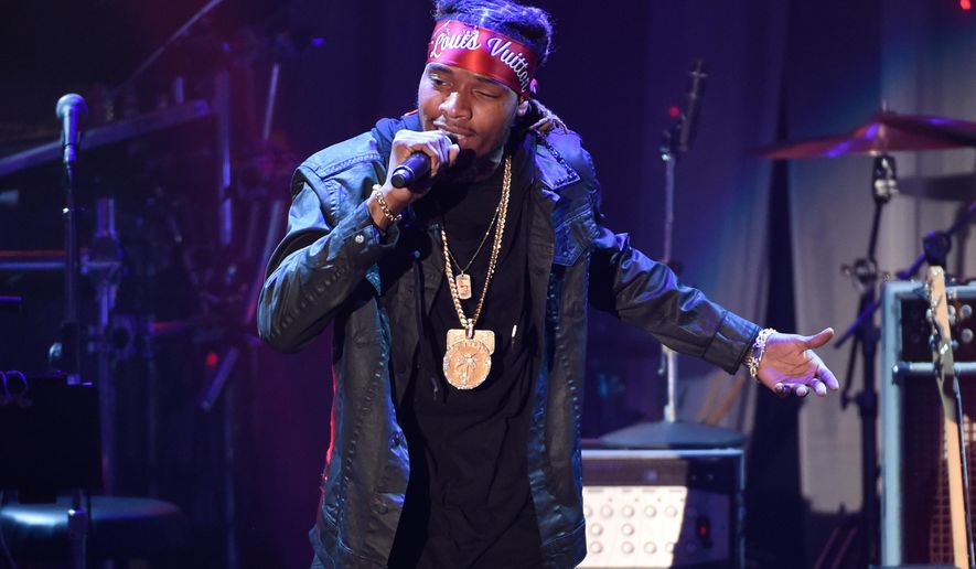 FILE - In this Feb. 14, 2016 file photo, Fetty Wap performs at the 2016 Clive Davis Pre-Grammy Gala in Beverly Hills, Calif. A New Jersey school district is investigating how rapper Fetty Wap was allowed to record a music video that included drug references and a pole dancer in his old high school. (Photo by Chris Pizzello/Invision/AP, File)