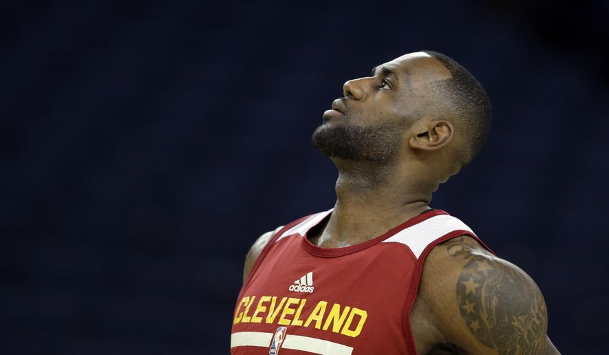Cleveland Cavaliers' LeBron James follows his shot during NBA basketball practice Wednesday, June 1, 2016, in Oakland, Calif. The Golden State Warriors host the Cleveland Cavaliers in Game 1 of the NBA finals on Thursday. (AP Photo/Marcio Jose Sanchez)