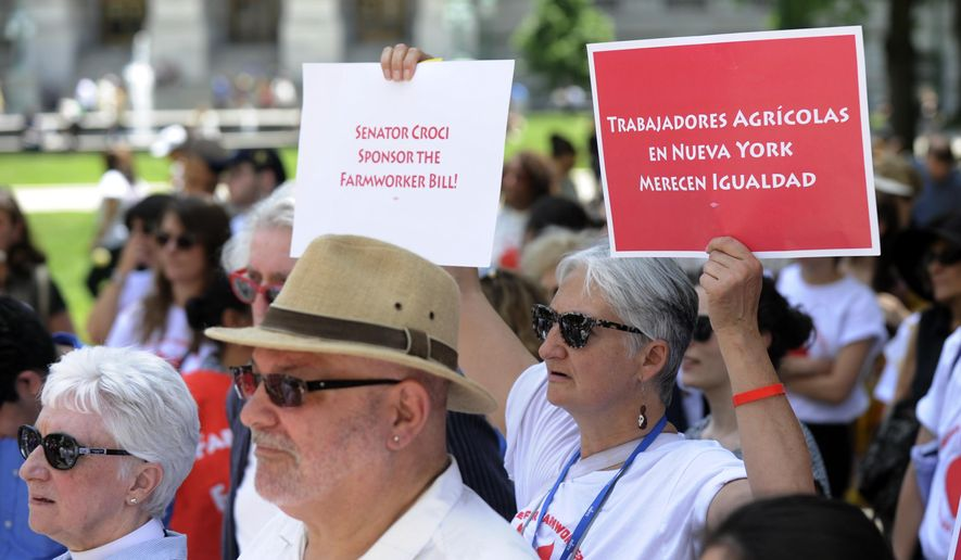 Advocacy groups join farm workers during a rally outside the state Capitol on Wednesday, June 1, 2016, in Albany, N.Y. Farm workers from Long Island marched to Albany to bring attention for legislative action to end the inequality that currently burdens farmworkers in the state. (AP Photo/Hans Pennink)