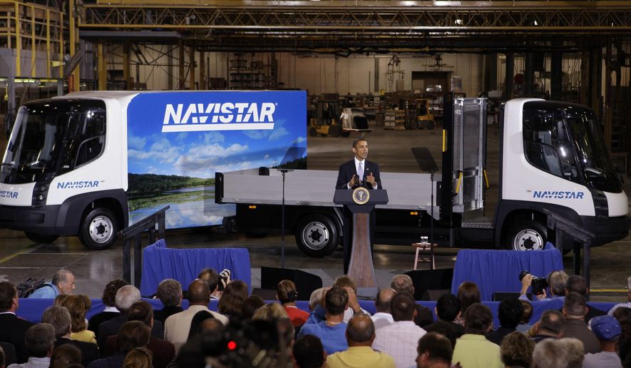 FILE -  This Aug. 5, 2009 file photo shows President Barack Obama as he delivers remarks on the economy in front of Navistar's all-electric commercial truck at a manufacturing plant in Wakarusa, Ind. Obama, who made his first trip as president to nearby Elkhart, Ind. will visit Concord High School in Elkhart on Wednesday, June 1, 2016. (AP Photo/Michael Conroy, File)