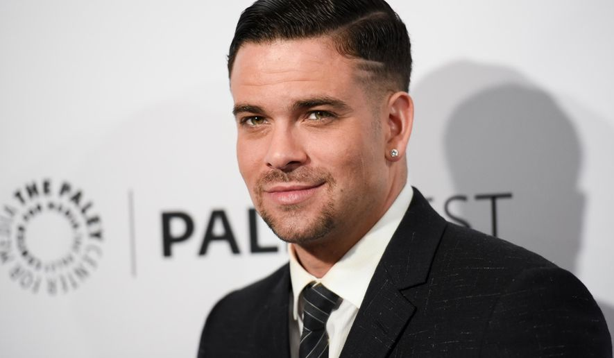 """FILE - In this March 13, 2015 file photo, Mark Salling arrives at the 32nd Annual Paleyfest """"Glee"""" in Los Angeles. Salling, who was charged May 27, 2016, with receiving and possessing child pornography, has been dropped from the miniseries """"Adi Shankar's Gods and Secrets,"""" which stars Denise Richards and Jane Seymour. (Photo by Richard Shotwell/Invision/AP, File)"""