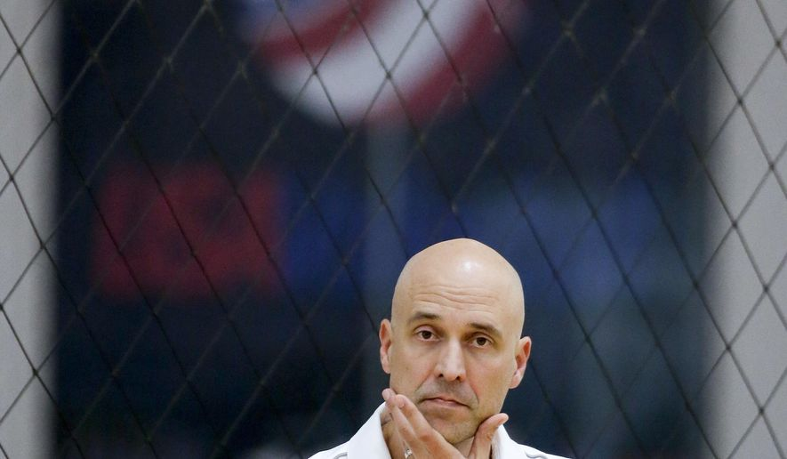 In this photo taken Wednesday, May 25, 2016, U.S. men's volleyball coach John Speraw watches during practice in Anaheim, Calif. Speraw has received a contract extension to lead the Americans through the 2020 Olympic cycle in Tokyo, USA Volleyball announced Wednesday, June 1, 2016. (AP Photo/Chris Carlson)