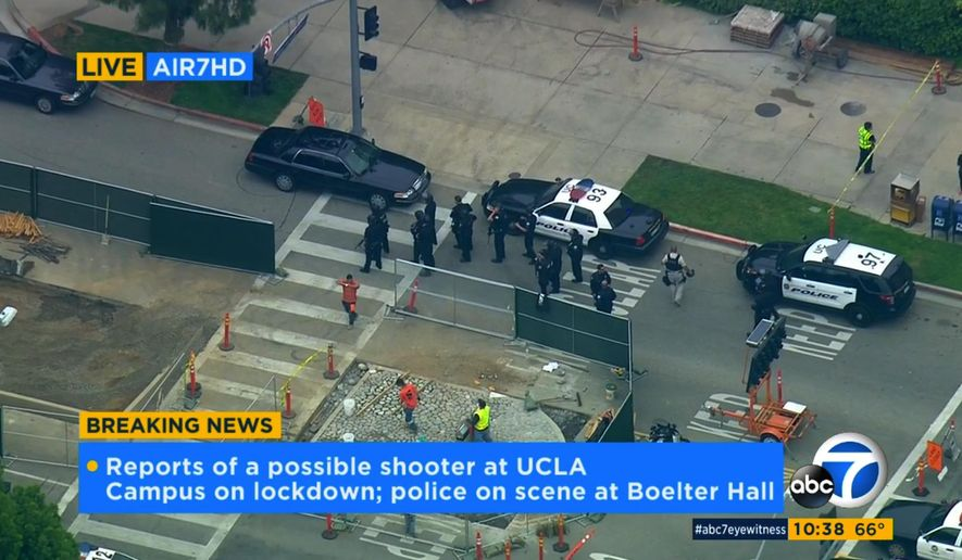In this image made from video, police respond to a report of a possible shooter at the University of California, Los Angeles, Wednesday, June 1, 2016, in Los Angeles. (KABC-7 via AP) MANDATORY CREDIT