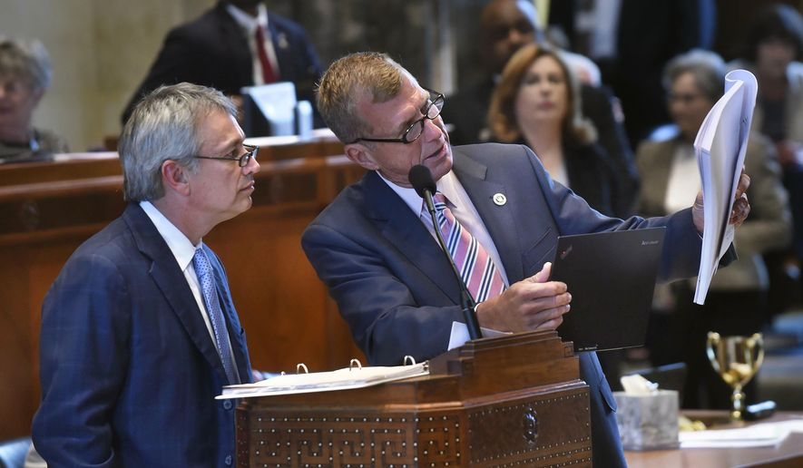 Sen. Eric LaFleur, D-Ville Platte, left, listens to a question from Sen. Mike Walsworth, R-West Monroe, right, holding his laptop and a copy of state budget House Bill 1, shortly before all but two Senators voted to send the bill on to the House, Wednesday, June 1, 2016 at the Louisiana State Capitol in Baton Rouge. LaFleur was handling the bill in the Senate for its author, House Appropriations Committee chairman Cameron Henry, R-Metairie. (Travis Spradling/The Baton Rouge Advocate via AP)