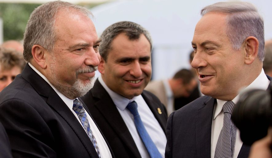 Israeli Prime Minister Benjamin Netanyahu (right) suddenly brought the ultranationalist party into his ruling coalition last week by naming the party's hawkish leader, Avigdor Lieberman (left), as Israel's defense chief. (Associated Press)