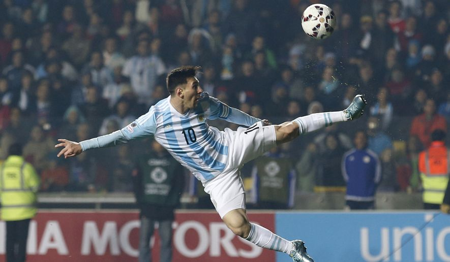 FILE - In this June 30, 2015, file photo, Argentina's Lionel Messi kicks the ball during a Copa America semifinal soccer match against Paraguay at the Ester Roa Rebolledo Stadium in Concepcion, Chile. (AP Photo/Silvia Izquierdo, File)