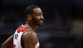Washington Wizards guard John Wall (2) smiles in the first half of an NBA basketball game against the Portland Trail Blazers, Monday, Jan. 18, 2016, in Washington. (AP Photo/Alex Brandon)