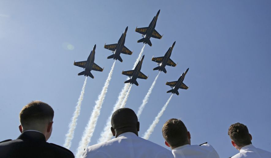 The U.S. Navy's Blue Angels flight demonstration team performs a flyover above graduating U.S. Naval Academy Midshipmen during the Academy's graduation and commissioning ceremony in Annapolis, Md., on May 27, 2016. (Associated Press)