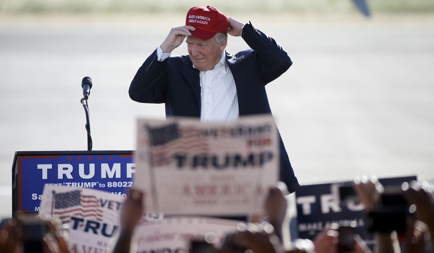 Republican presidential candidate Donald Trump wears his hat at a rally, Wednesday, June 1, 2016, in Sacramento, Calif. (AP Photo/Jae C. Hong)