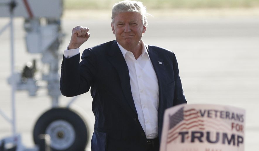Republican presidential candidate Donald Trump pumps his fist as he arrives to speak at a rally Wednesday, June 1, 2016, in Sacramento, Calif. (AP Photo/Jae C. Hong)