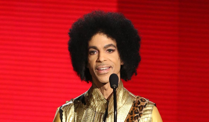 In this Nov. 22, 2015, file photo, Prince presents the award for favorite album - soul/R&B at the American Music Awards in Los Angeles. A law-enforcement official says that tests show the music superstar died of an opioid overdose. Prince was found dead at his home on April 21, 2016, in suburban Minneapolis. He was 57. (Photo by Matt Sayles/Invision/AP, File)