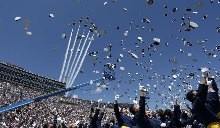 Air Force Academy graduates throw their caps into the air as F-16 jets from the Thunderbirds make a flyover, at the completion of the commencement ceremony for the Air Force Class of 2016, at the U.S. Air Force Academy, in Colorado Springs, Colo., Thursday, June 2, 2016. (AP Photo/Brennan Linsley)