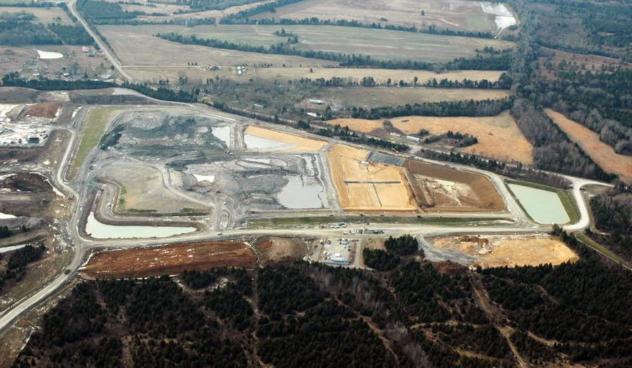 This file photograph taken Feb. 10, 2010, shows the massive Arrowhead Landfill near Uniontown, Ala. Opponents of the landfill are asking a federal court to dismiss a slander lawsuit filed by the Georgia-based landfill operators, Thursday, June 2, 2016, who contend they have been wrongly maligned by false allegations and protests over the operation. The landfill accepted tons of coal ash spilled during an accident at a Tennessee Valley Authority electricity plant in Tennessee December 2008. (AP Photo/Jay Reeves)