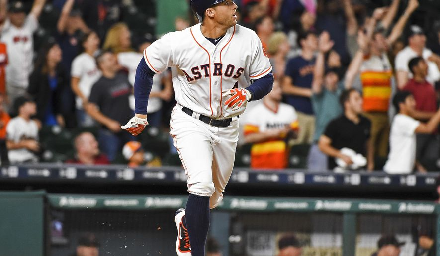 Houston Astros' George Springer watches his game-winning solo home run during the 11th inning of a baseball game against the Arizona Diamondbacks, Wednesday, June 1, 2016, in Houston. Houston won 5-4. (AP Photo/Eric Christian Smith)