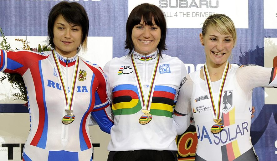 FILE In this Saturday, April 7, 2012 file photo, Australia's Anna Meares, center, Germany's Kristina Vogel, right, and Russia's Yekaterina Gnidenko celebrate with their medals won in the women's Keirin at the Track Cycling World Championships in Melbourne, Australia. The International Cycling Union said Yekaterina Gnidenko was suspended after failing a doping test on a sample taken shortly before the 2012 London Olympics, though it was not immediately clear if this was part of the IOC retesting program. (AP Photo/Andrew Brownbill, file)