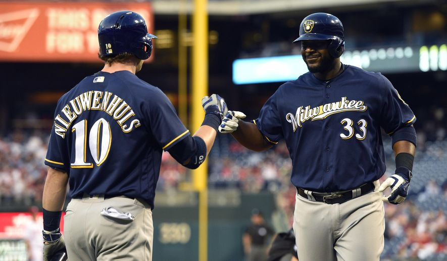 Milwaukee Brewers' Chris Carter, right, is greeted by Kirk Nieuwenhuis after Carter hit a solo home run off Philadelphia Phillies' Jerad Eickhoff during the fourth inning of a baseball game, Thursday, June 2, 2016, in Philadelphia. (AP Photo/Derik Hamilton)