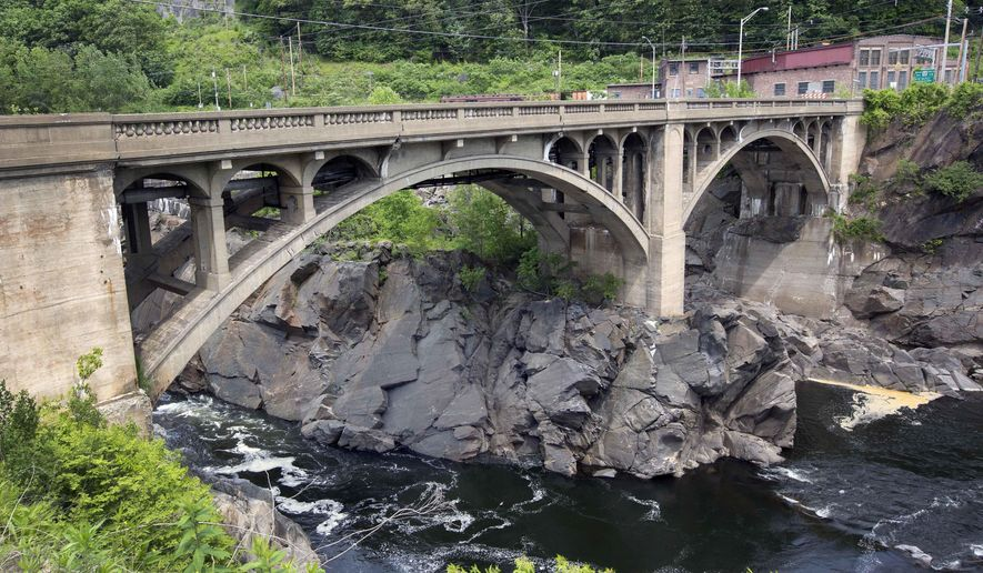 The closed 86-year-old Vilas Bridge connecting Bellows Falls, Vermont with Walpole, N.H. spans the Connecticut River Thursday, June 2, 2016, in Bellows Falls, Vt. Some Vermont officials unhappy over stalled repairs to a long-closed bridge are suggesting that a federal judge step in to fix things. (AP Photo/Jim Cole)