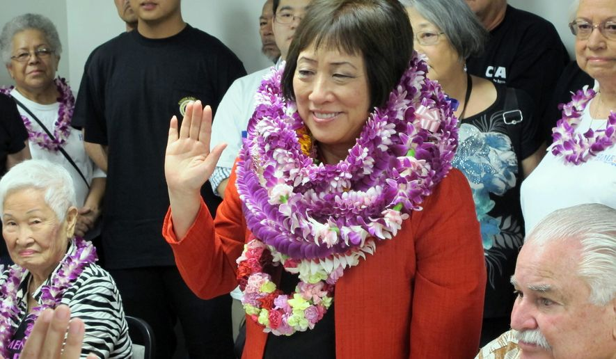Former U.S. Rep. Colleen Hanabusa takes an affirmation pledge as she files papers to run for her old seat in Congress on Thursday, June 2, 2016 in Honolulu. Hanabusa says she decided to enter the race after colleagues including outgoing U.S. Rep. Mark Takai asked her to run.  (AP Photo/Cathy Bussewitz)