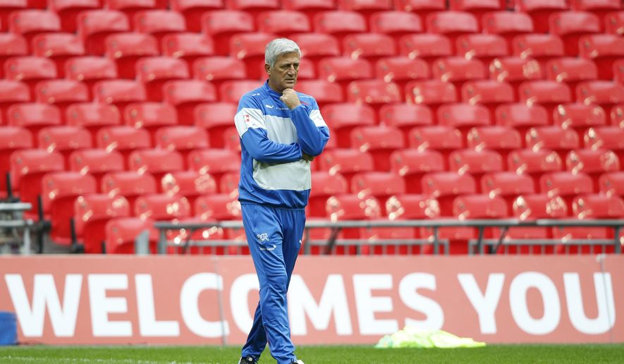 FILE - In this Monday, Sept. 7, 2015 file photo, Switzerland's soccer team head coach Vladimir Petkovic walks on the pitch at Wembley Stadium prior to his team holding a practice session in London. For some just reaching the European Championship is enough. However, from the players to coaches and referees to administrators, many have something to prove in France. (AP Photo/Alastair Grant, File)