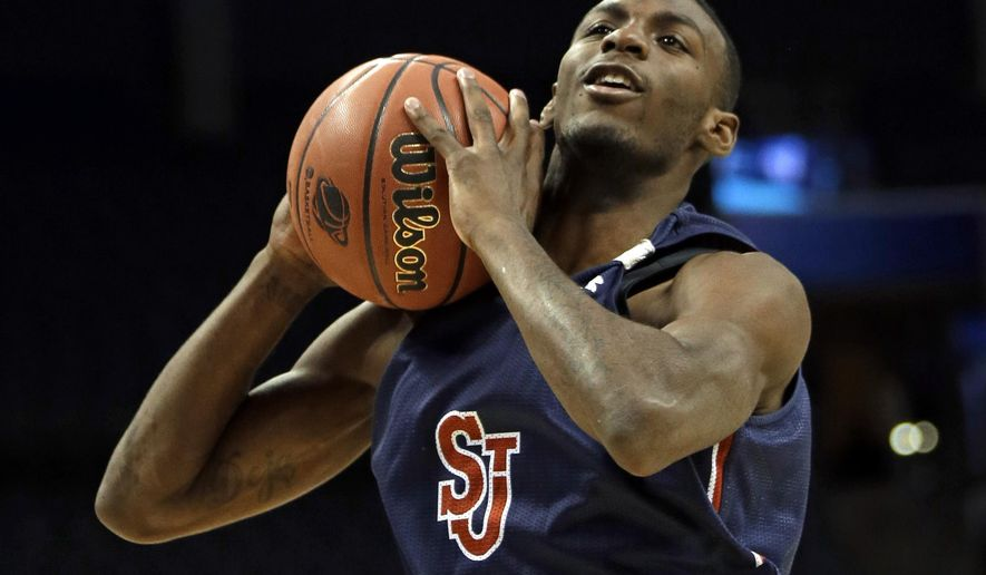 FILE - In this March 19, 2015, file photo, Rysheed Jordan grabs a rebound during practice at the NCAA college basketball tournament in Charlotte, N.C. ahead of an NCAA tournament game. Police say Jordan has been charged in connection with a May 27, 2016, shooting in Philadelphia. (AP Photo/Gerald Herbert, File)