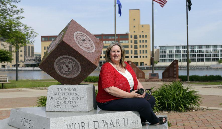 Melinda Roberts has been photographing veterans memorials across the state. Melinda Roberts of De Pere, here in Veterans Memorial Park in Green Bay, has been photographing veterans memorials across the state. (Jim Matthews/Green Bay Press-Gazette via AP)