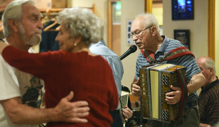 ADVANCE FOR RELEASE SATURDAY, JUNE 4, 2016, AT 3:01 A.M. EDT. AND THEREAFTER - In this May 23, 2016 photo, Norm Cimino sings and plays the accordion during SNPJ Polka Jam in Strabane, Pa. The lodge hosted an appearance from a Cleveland polka band. (Celeste Van Kirk/Observer-Reporter via AP) MANDATORY CREDIT