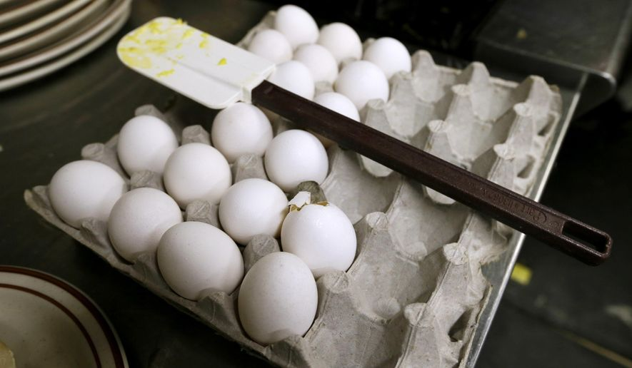 FILE - In this June 19, 2015, file photo, eggs wait to be cooked at a cafe in Des Moines, Iowa. The U.S. Food and Drug Administration resumed inspections Wednesday, June 1, 2016, of egg-handling facilities in 21 states more than a year after they were suspended due to the nation's worst bird flu outbreak. (AP Photo/Charlie Neibergall, File)