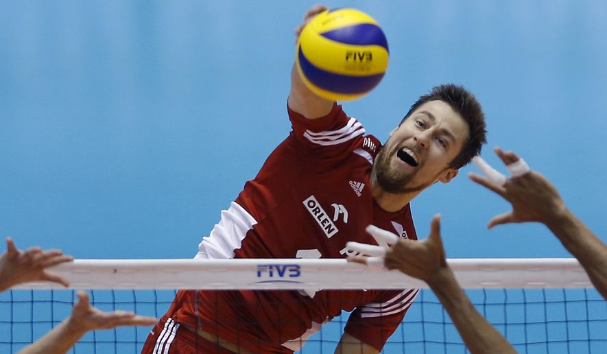 Michal Kubiak of Poland spikes against Venezuela during the Men's Volleyball World Olympic Qualification Tournament match in Tokyo, Japan, Thursday, June 2, 2016. (AP Photo/Shizuo Kambayashi)